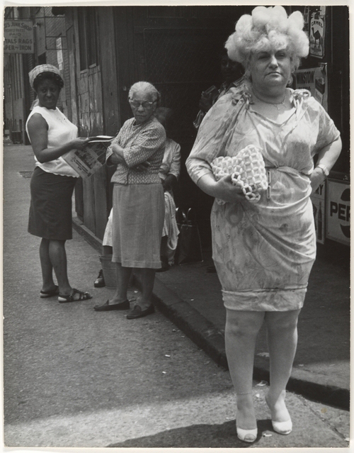 Leon Levinstein - street-scene woman in blonde wig and tight dress - New York City 1960s