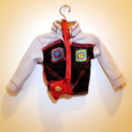 Josiane Keller - Molly's sports jacket with red leather purse - front