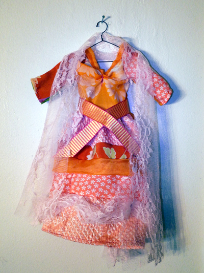 Josiane Keller - Vincent's orange Japanese silk dress and salmon lace veil