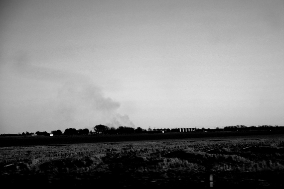 Edie Weisslechner - smoke coming from a farm in the distance
